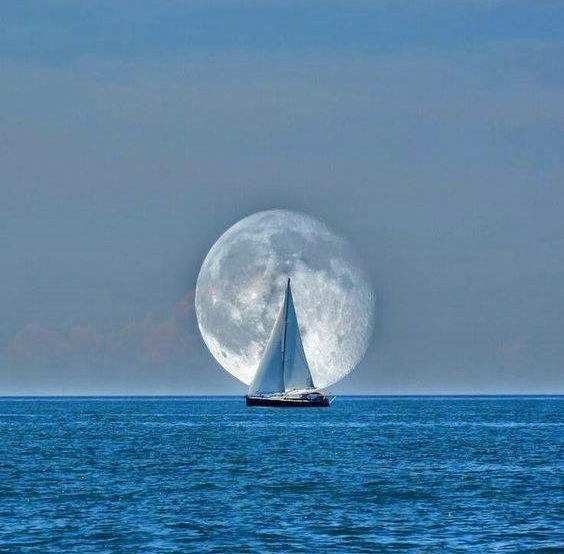 Sailboat moon in background along horizon